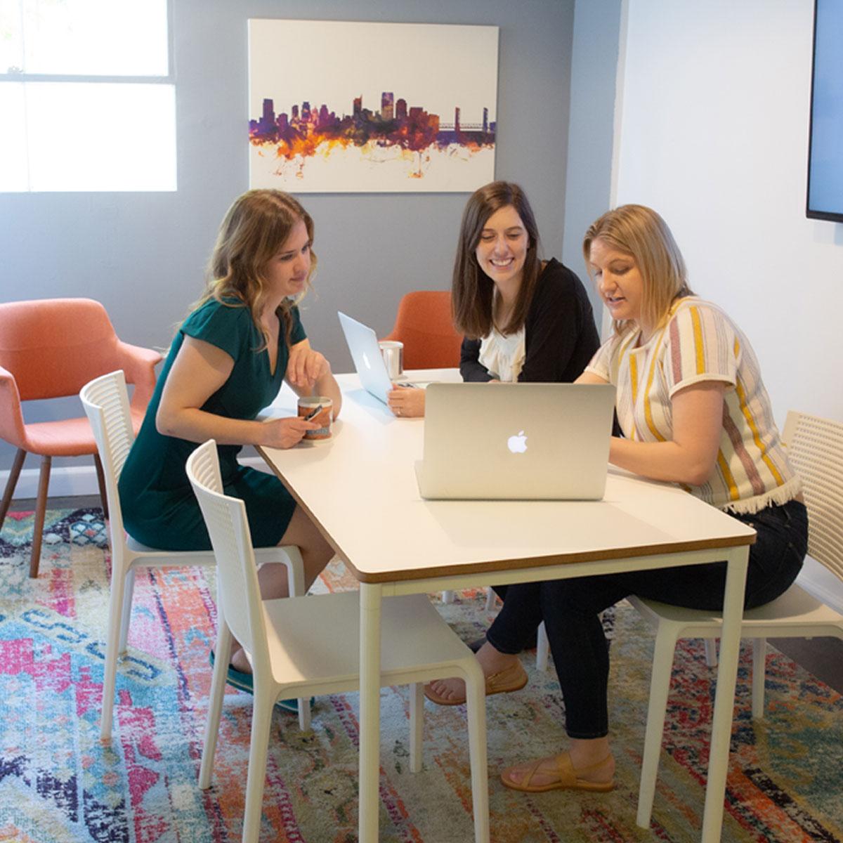 Members working in a meeting room